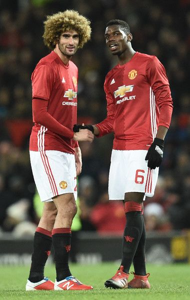 Manchester United's Belgian midfielder Marouane Fellaini (L) celebrates with Manchester United's French midfielder Paul Pogba following the EFL (English Football League) Cup semi-final football match between Manchester United and Hull City at Old Trafford in Manchester, north west England on January 10, 2017..Manchester United won the match 2-0. / AFP / Oli SCARFF / RESTRICTED TO EDITORIAL USE. No use with unauthorized audio, video, data, fixture lists, club/league logos or 'live' services…