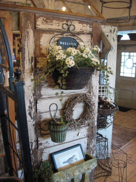 WOW! This is a gorgeous way to use an old door as a shop display!