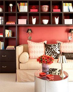 LOVE this! <3    Cozy Living Room    Amanda Nisbet Design    Create a cozy nook in your living room by installing a wall unit that runs the length of the room. Choose flirty shades of brown and pink to make it a more playful setting.
