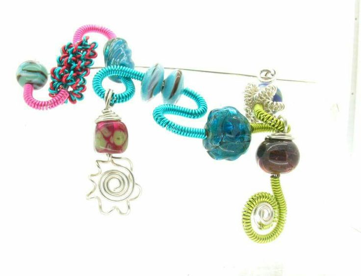 Wire brooch with glass beads