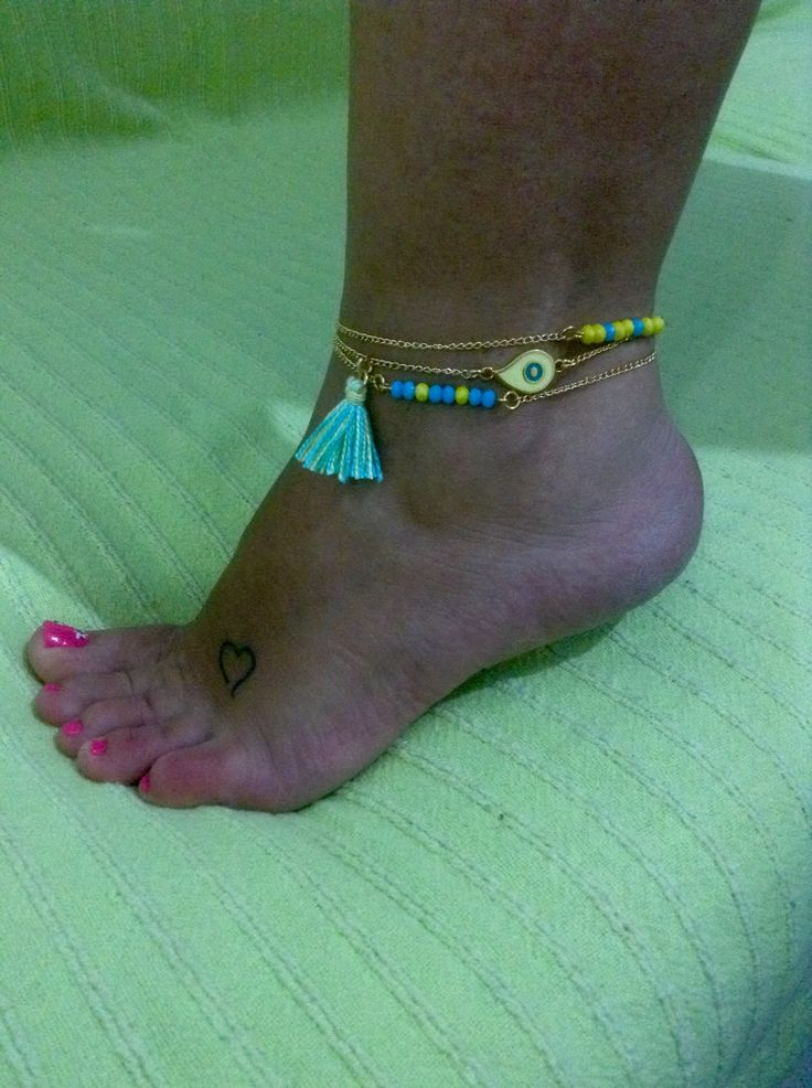 Leg bracelet with tassel and evil eye