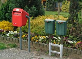 Left: public mailbox, right: two private mailboxes in the Netherlands
