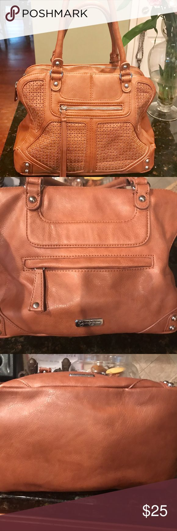 """Jessica Simpson purse LOTS of room! Great Neutral color Jessica Simpson purse with lots of room for all your needs. 3 separate zip compartments and 2 outside zip compartments. I got plenty of use out of this and it's still in great shape for you to also! Nice sturdy purse that stands up on its own. I ship within  24 hours👜 Great Used Condition. No marks or stains. I just feel like it lost some of its shape. Once it's filled with your essentials, it'll be nice and full;) 12""""width x 9""""height…"""