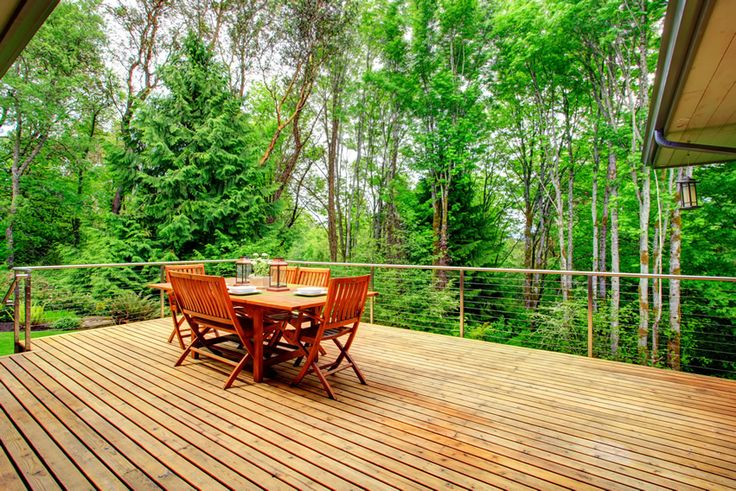 Beautiful wood deck with table and chairs and nature-view