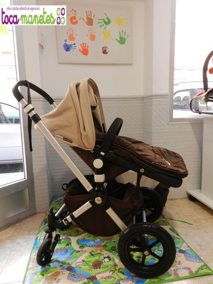 Bugaboo Cameleon de segunda mano en perfecto estado. En color chocolate. 2 piezas: Capazo + silla de paseo. Incluye saco y plástico para la lluvia. PVP TocaManetes: 650€.