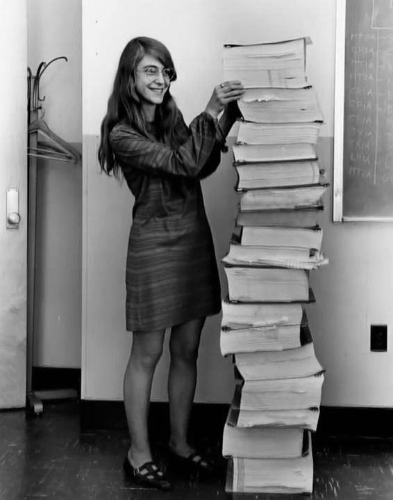 Margaret Hamilton with a stack of printed output from early versions of software for Apollo 8/11, ca 1967