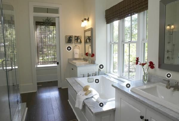 Beautiful bathroom with dark wood espresso floors, spa tub ...