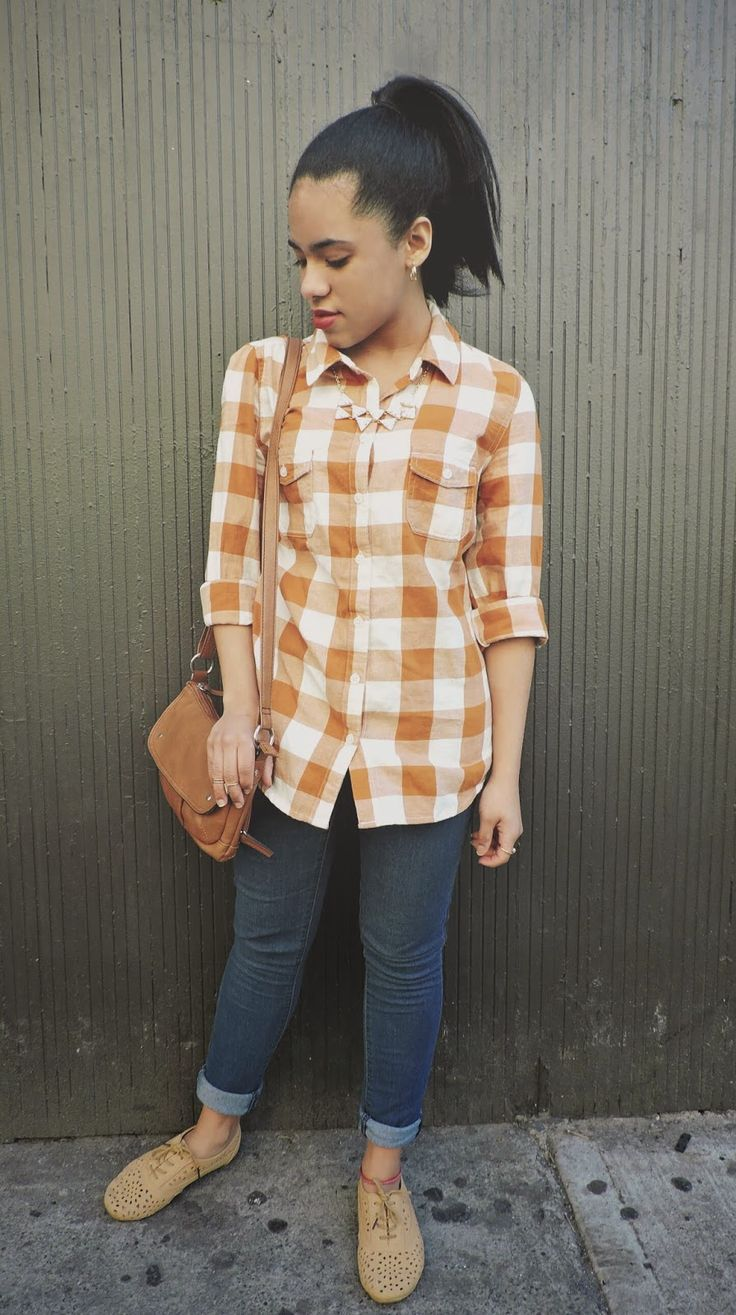 An orange gingham button-up shirt and dark blue slim jeans will showcase your sartorial self. Camel suede oxford shoes are a wonderful choice to complete the look.   Shop this look on Lookastic: https://lookastic.com/women/looks/dress-shirt-skinny-jeans-oxford-shoes-crossbody-bag-necklace/9869   — Orange Gingham Dress Shirt  — Navy Skinny Jeans  — Tan Suede Oxford Shoes  — Brown Suede Crossbody Bag  — White Necklace