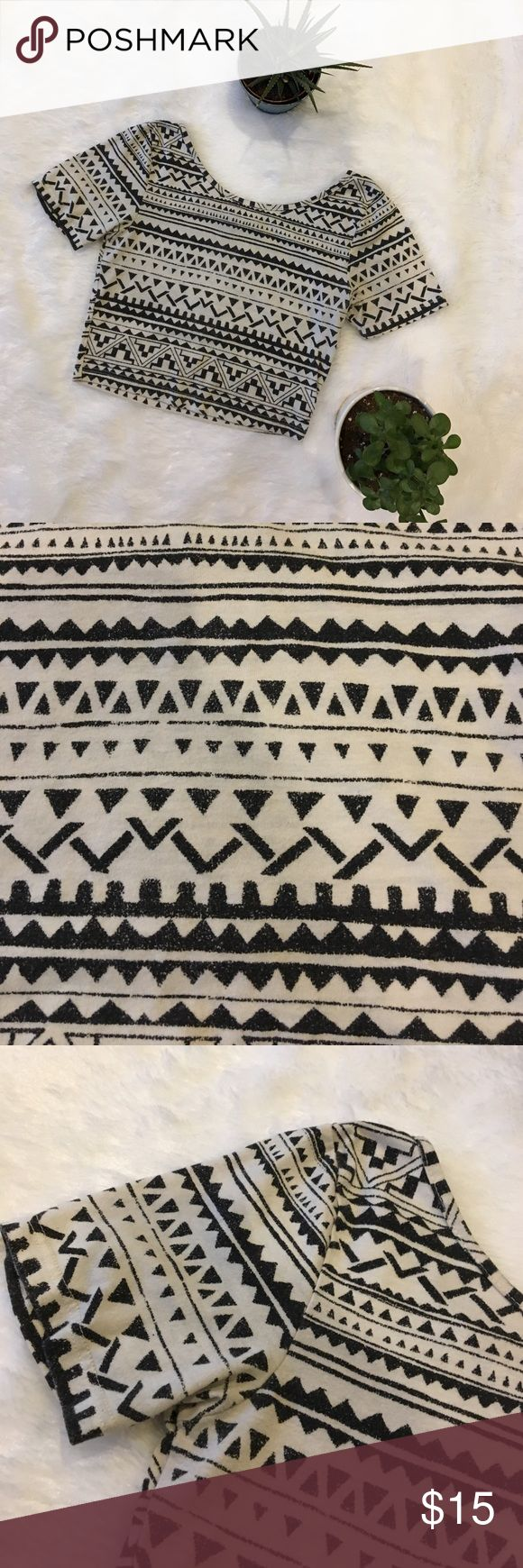 Aztec Crop Top Shirt Short Sleeve Short sleeve fitted Crop Top by Nollie! Women's Size XS. Cream/tan background with black Aztec pattern. In great condition!! Nollie Tops Crop Tops