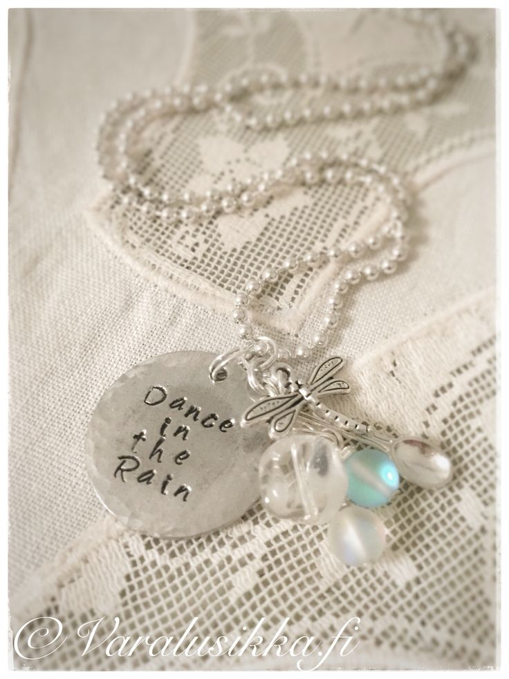 Dance in the Rain. Hand stamped, hand made spoon necklace with aqua blue and white frosted beads and rock chrystal. www.varalusikka.fi