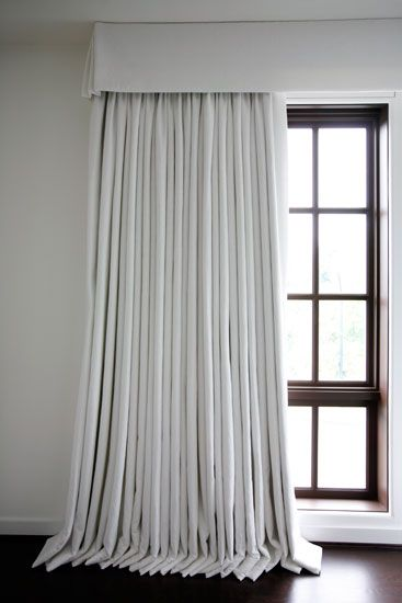 White linen curtains, flat valance with kick-pleat corners