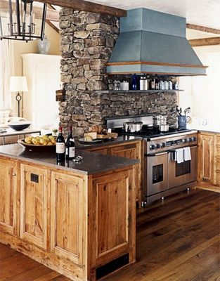 Rustic kitchen with a pop of color from that beautiful stove hood!