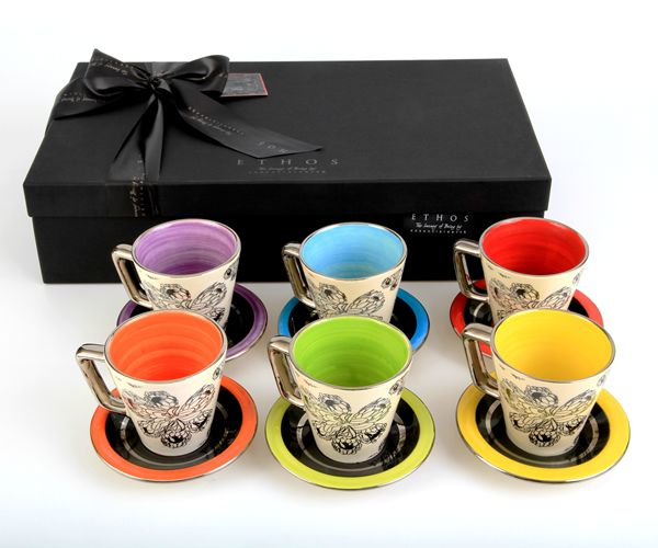 Our beautiful Protea Tea Set comes in a set of 6 bright colours, all hand-painted with a touch of Platinum, this exclusive set is truely an example functional art. #protea #tea #colorful #cups #decor