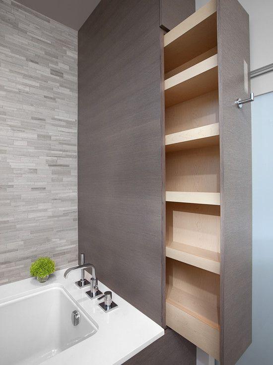 Hidden storage in a modern bathroom. Gorgeous tile selection! http://www.interiorsbystudiom.com/blog/2013/07/custom-cabinetry-bathroom-design-built-in-cabinets/