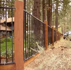 metal fence with wood posts