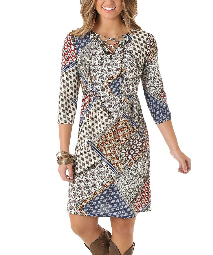 A simple silhouette on this a-line dress provides lasting comfort while a bold print and cross-tie neckline add extra feminine flair.100% polyesterMachine washImported
