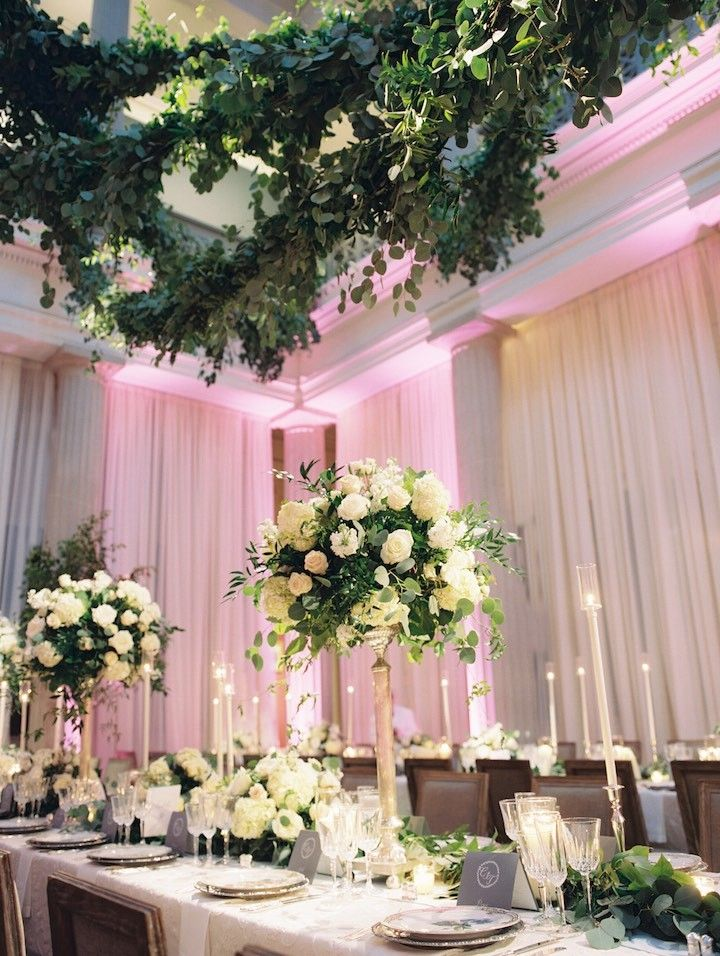 Elegant wedding centerpiece idea; photo: Abby Jiu