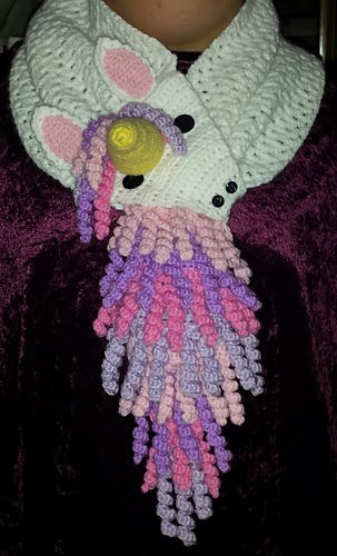 This is a crochet pattern for a unicorn scarf. The size is adult, but can easily fit teens and pre-teens, and the length can be changed to suit your needs.