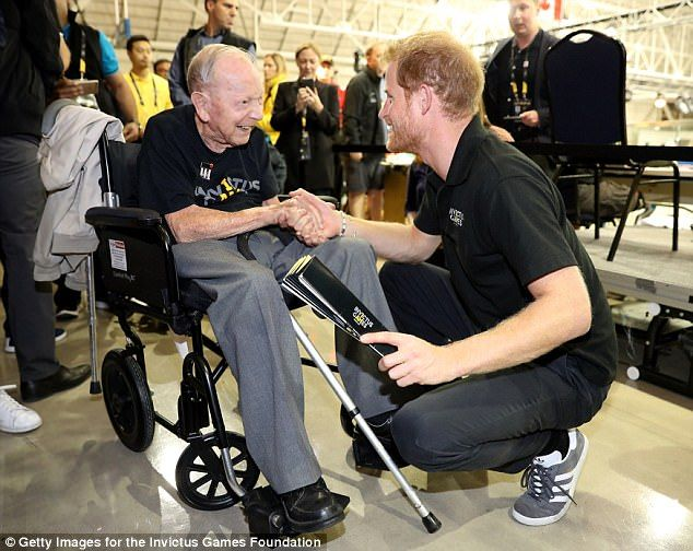 Personal meeting: The prince surprised Sgt James Norman Baker at the start of the tournament, after theWorld War II veteran made a speech about the royal