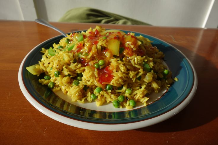 Turmeric and black pepper rice with onion, capsicum and pea.  +sweet chilli sauce.