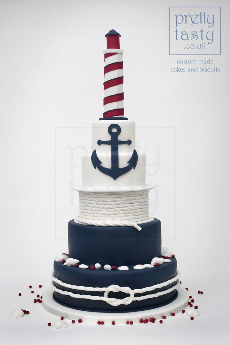 Navy and fuchsia lighthouse cake with shells and nautical elements. Perfect for a seaside wedding. #prettytasty.co.uk #wedding #cake
