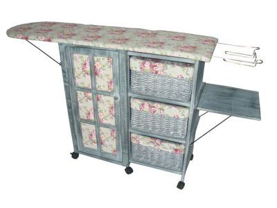 "Ironing Day Station - - - - -     A fabulous fabric care fixture is guised as a charming display. Chintz and dove grey cabinet with French door offers stash drawers and cubbies. Caster wheels. 33 x 30 x 13"" extended. 58"" ironing board."