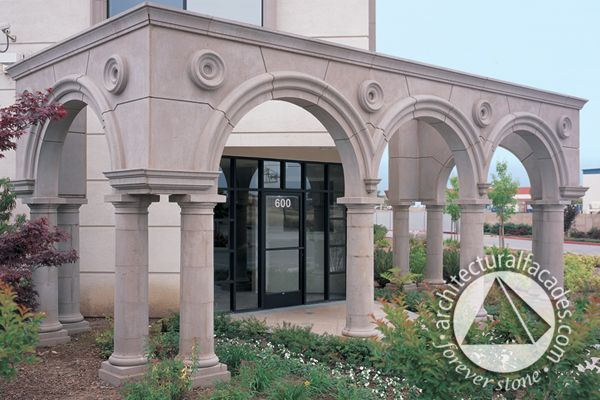 Great entrance with columns and trim details in cast stone.