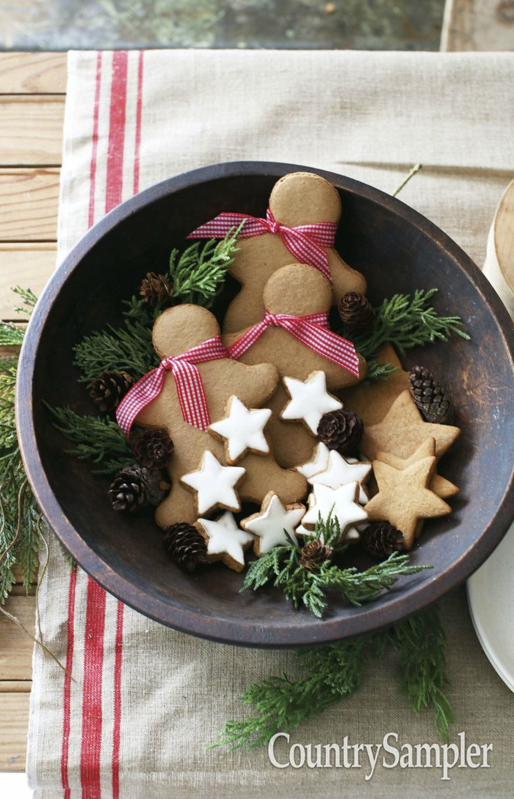Fill a dough bowl with ribbon-trimmed gingerbread men and stars tucked amid greens for an edible arrangement.