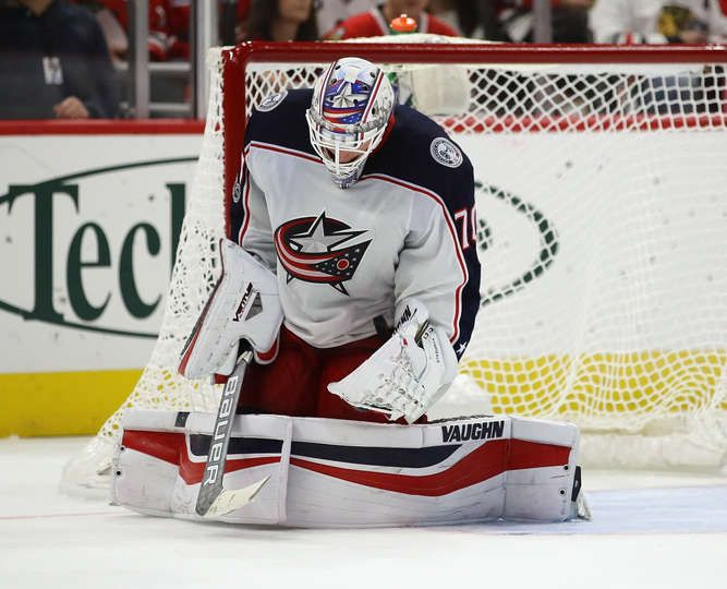 CHICAGO, IL - SEPTEMBER 23: Joonas Korpisalo #70 of the Columbus Blue Jackets makes a save against the Chicago Blackhawks during a preseason game at the United Center on September 23, 2017 in Chicago, Illinois. The Blue Jackets defeated the Blackhawks 3-2. (Photo by Jonathan Daniel/Getty Images)