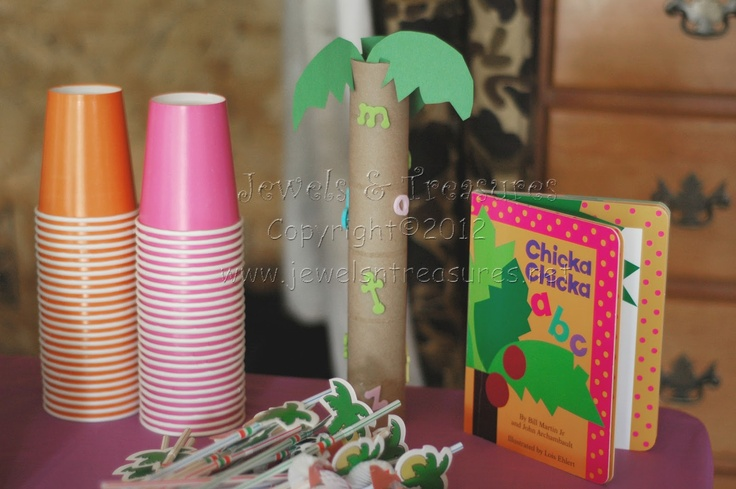 Toilet paper rolls decorated with dollar-store letter stickers.  Also, palm-tree straws.