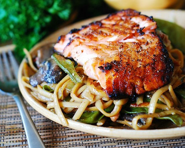 Asian Salmon:  2 tablespoons sesame oil  1 pound salmon  salt & pepper  1 tablespoon honey  1 tablespoon soy sauce. Heat sesame oil in skillet. Sear non-skin side 4 min, moving it around in the oil to keep moist; sear skin side 3 min, discard skin. Mix soy & honey, nuke to soften. Smear on salmon and broil 3 min, smear again, broil 3 more min until almost charred. Let sit if not cooked thru yet.