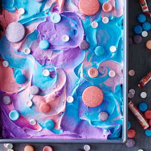 6 Poke Cakes You Need in Your Life | SweeTARTS and Smarties Tie-Dye Cake  | MyRecipes