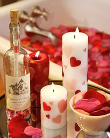 Romantic Candle How-To:  1. Punch hearts from a sheet of wax using heart-shaped craft punches.    2. While holding a single wax heart with chopsticks, heat the pillar candle and wax heart using a blow-dryer (this will soften the wax heart, causing it to adhere to the candle).    3. Repeat this process until you have attached the desired number of hearts to the candle.