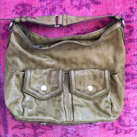 Marc by Marc Jacobs olive green purse. Olive green purse. Marc by Marc Jacobs. Used but in great condition. Interior is perfect aside from blue ink stain which is shown in 3rd picture. Offers accepted! Marc by Marc Jacobs Bags