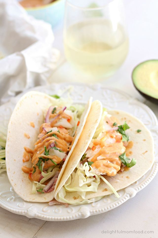 Easy cod fish tacos with southwest sauce! Pan sear cod fish in lime to seal in the juices then transfer to a baking dish. Bake at 350 degrees for