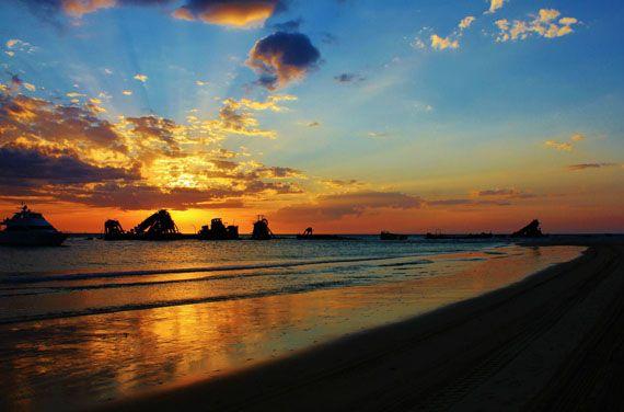 Moreton Island: Sunset over the Tangalooma Wrecks in Moreton Bay, just two kilometres north of Tangalooma Island Resort. Photo: Barb Hall. #sunset #island #wrecks #beach #brisbane