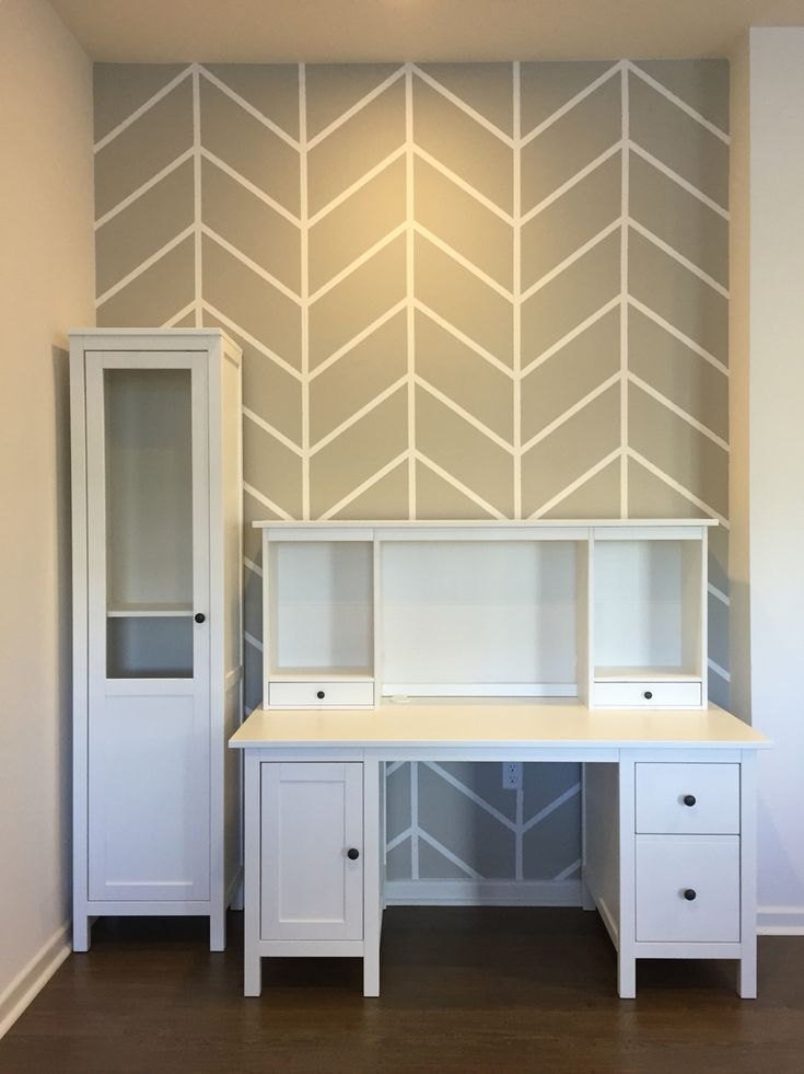 DIY herringbone pattern accent wall with paint and painters tape.