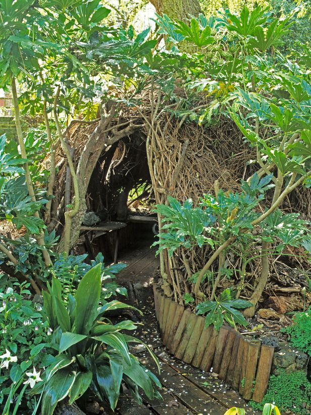 Secret Hideaway.    In a secret corner of this densely planted garden, a den of willow and brushwood becomes the focus of adventure and discovery, providing an escape from the adult world.