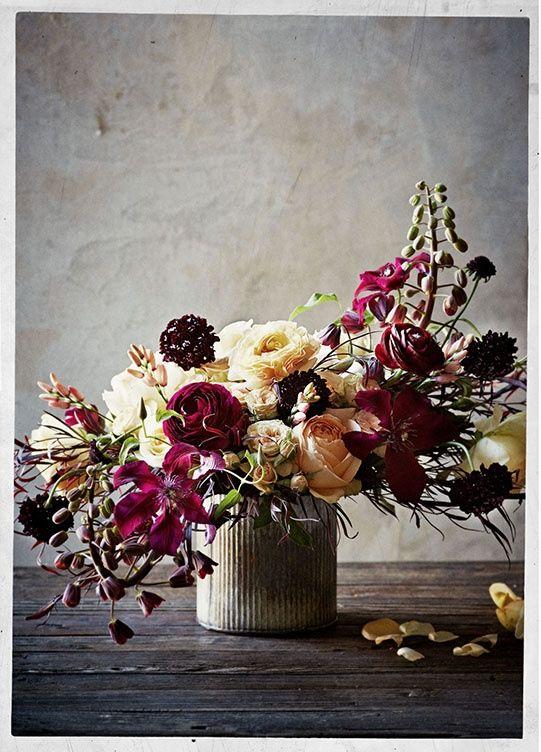 stunning floral arrangement. i love the addition of the deep plum ranunculus.