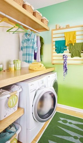 Maximize space in a laundry room with a wall mounted drying rack for drying delicate clothes. Laundry Room Organization Tips | Tiny Homes