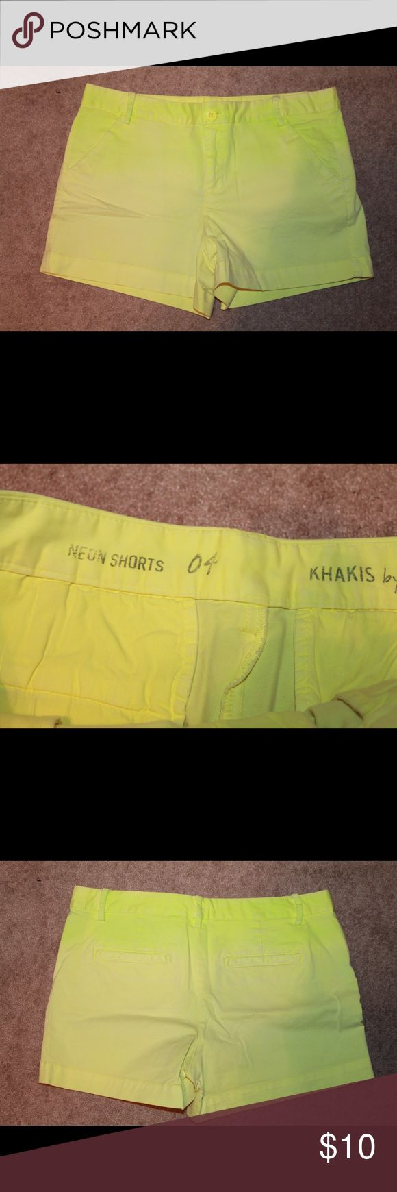 GAP women's size 4 neon shorts Great condition. GAP women's size 4. Neon yellow khakis. Darker at the top and fade out to lighter towards the bottom. GAP Shorts