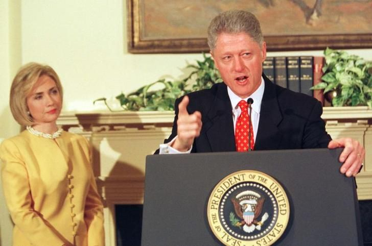 CLINTON First Lady Hillary Clinton stands next to President Clinton as he delivers his strongest public denial of allegations that he had an affair with former intern Monica Lewinsky, during a news conference at the White House last January 26, 1998. REUTERS/Win McNamee