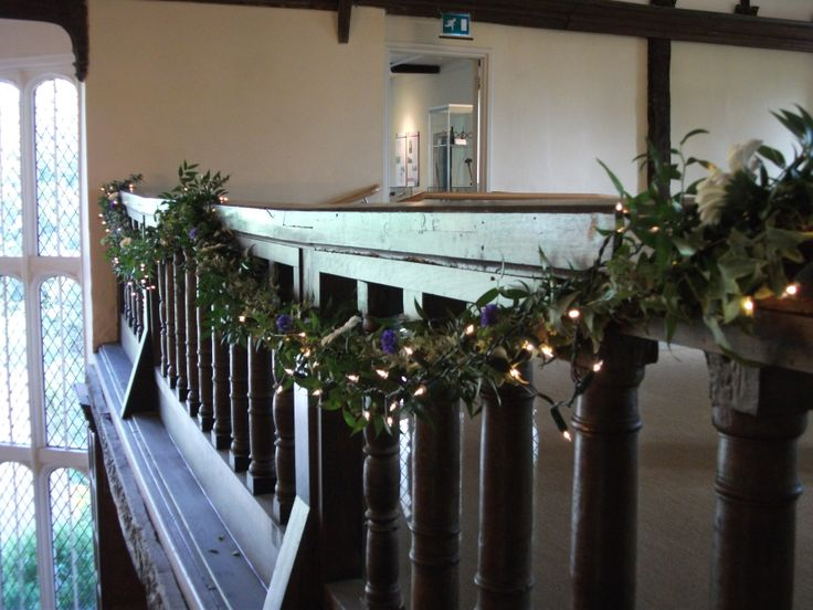 The Minstrels Gallery in The Great Chamber, dressed with a foliage and fairy light garland