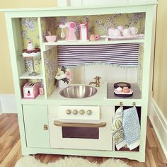 """I really really like to craft, and my husband is a saint for putting up with me. This has been our """"night time"""" project for the past 4 weeks once the kids are in bed, and I have to say, this old entertainment center turned retro Harp kitchen is my favorite project to date. Harper is totally getting her birthday present early... because I can't wait any longer... and because I want to play."""