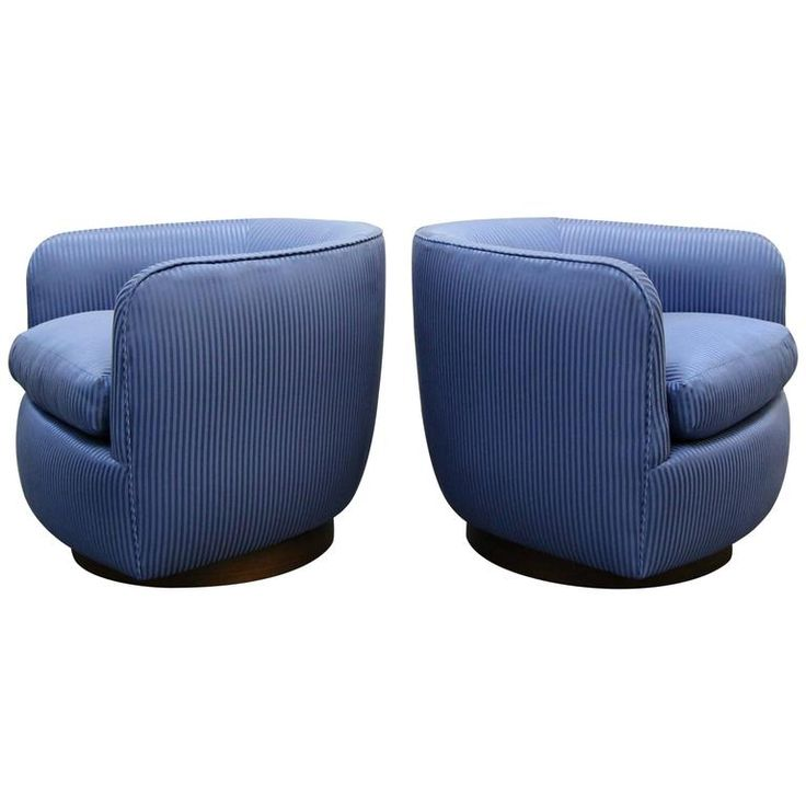 Pair of Mid-Century Rocking Swivel Barrel Chairs with Walnut Plinth | From a unique collection of antique and modern lounge chairs at https://www.1stdibs.com/furniture/seating/lounge-chairs/