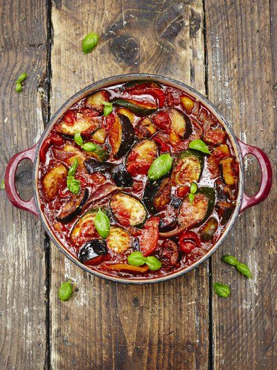 The Classic Yet Mouth-Watering Ratatouille Ingredients: 2 red onions 4 cloves of garlic 2 aubergines 3 courgettes 3 red or yellow peppers 6 ripe tomatoes ½ a bunch of fresh basil olive oil a few sprigs of fresh thyme 1 x 400 g tin plum tomatoes 1 tablespoon balsamic vinegar ½ a lemon Click on the link for the instructions