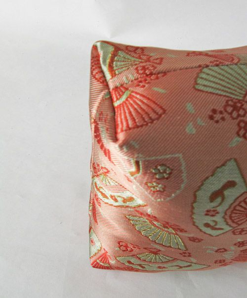 A box-edge or square pillowcase can be customized to fit anything from a chair to a picnic bench. Here's how to sew it yourself for a lovely DIY pillow!