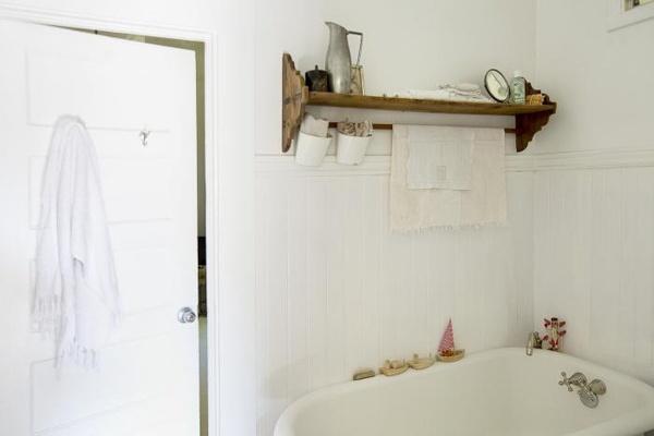 bathroom shelf above tub