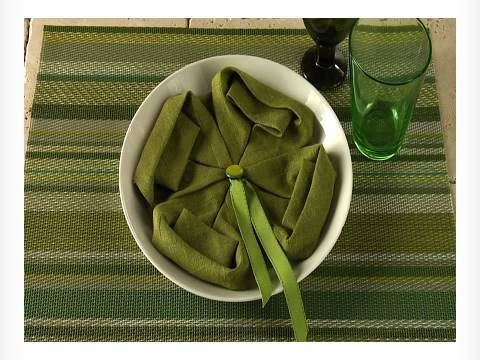 Watch more napkin folding videos - http://www.youtube.com/watch?v=mk7N-Rsv408=PL1C8C44F003DDC9B8     Subscribe to the BHG Channel- http://www.youtube.com/subscription_center?add_user=bhg     Use this simple folding technique to fold a napkin into a four-leaf clover for St. Patrick's Day. Take a green napkin and start by folding the four corners...