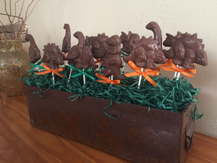 Milk Chocolate Dinosaur Lollipops...Display idea for dessert table.. The Land Before Time birthday party www.rosebudchocolates.com